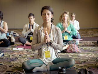people sitting doing meditation