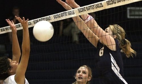 women's volleyball playing at the net