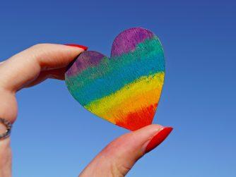 Hand holder rainbow heart