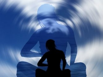 silhouette of woman with swirling clouds