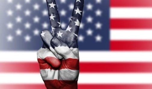 American Flag with hand with peace