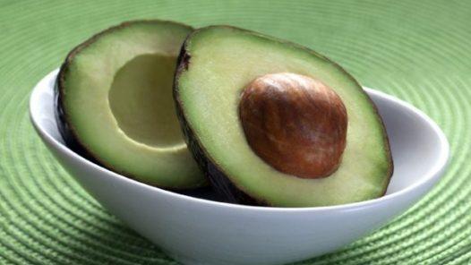 cut avocado in a white bowl