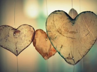 Three wooden hearts hanging on string