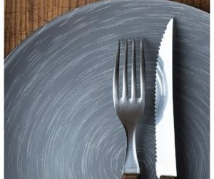 fork and knife on a grey plate