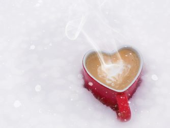 hot cocoa in red cup on snow