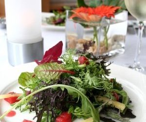 wild herbs on a dinner plate with glasses