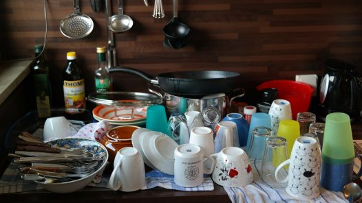 table with cleaned dishes on towels